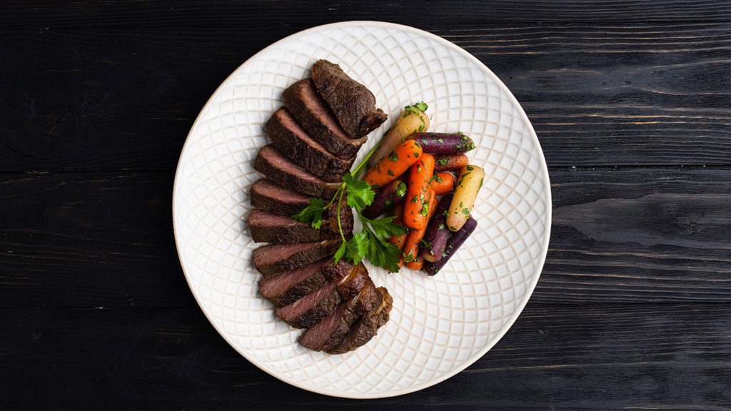 montreal steak with carrots