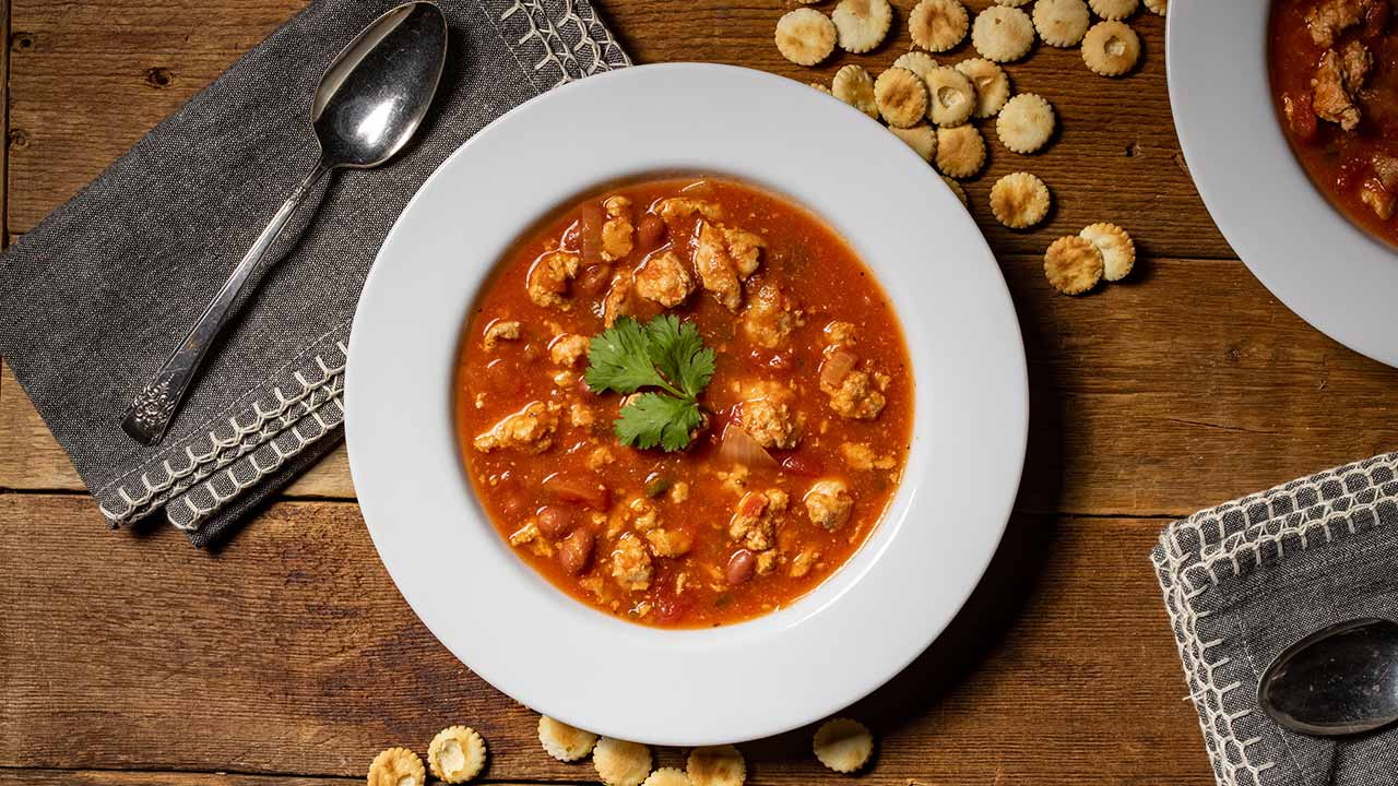 turkey chili in bowl with oyster crackers