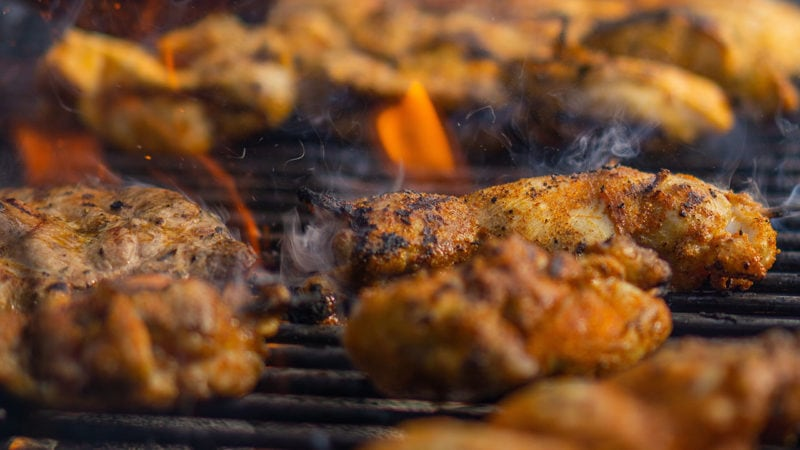 grilled chicken thighs on grill