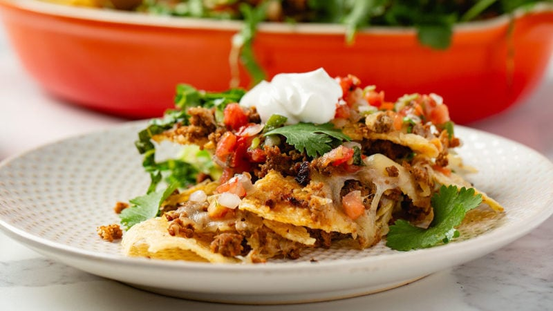 mexican-style chorizo crumbled in between layers of nachos